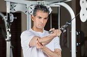 Mature man working out in fitness center