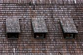 Wood shingle roof texture. Garret roof. Architectural textured  background.