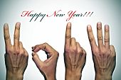 happy new year with hands forming number 2013