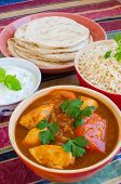 Chicken Rogan Josh with natural rice, cucumber-mint raita and naan breads