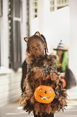 Girl dressed as cat for Halloween