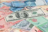 foto of ringgit  - American one hundred dollar bill and Asian currencies of India - JPG