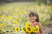 Young girl holding sunflowers