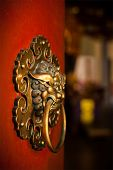 Doorknob of the Temple shaped as a jiaotu (dragon). Shuang Lin Temple, Singapore