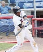 Binghamton Mets batter Cesar Puello swings  at a pitch