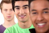 stock photo of backstabbers  - Ethnically diverse group of young men - JPG