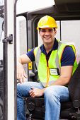 portrait of smiling young forklift driver