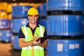 portrait of young worker in warehouse recording stock
