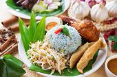 Nasi kerabu or nasi ulam, popular Malaysian Malay rice dish. Blue color of rice resulting from the petals of butterfly-pea flowers. Traditional Malaysia food, Asian cuisine.