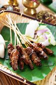 Beef satay, roasted meat skewer Asia food.  Traditional Southeast Asia food.  Hot and spicy Southeas