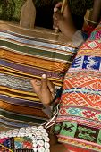 Woman Weaving A Rug In Peru