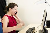 picture of pissed off  - Angry business woman screaming at her office - JPG