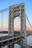 George Washington Bridge at sunset over Hudson River.