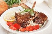 Roasted lamb chops with couscous, lemon and tomato