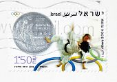 ISRAEL �¢�?�? CIRCA 2004: Stamp printed in Israel depicts a silver metal and judo competition In