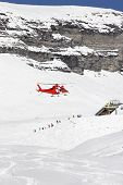 stock photo of rescue helicopter  - Rescue helicopter lands in a skiing region - JPG