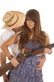 Cowboy Behind Woman With Gun Behind Hat