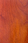 stock photo of formica  - texture of natural wood laminate cherry wood varnished - JPG