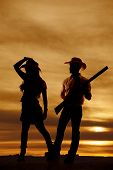 Silhouette of a Cowboy and Cowgirl
