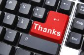 stock photo of thank you card  - thanks written on computer button to say thank you - JPG