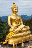 Seated Golden Buddha On Hilltop