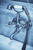 picture of bib tap  - The beautiful old faucet in a bathroom - JPG
