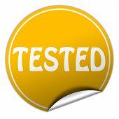 Tested Round Yellow Sticker On White Background