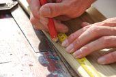 Preparing To Cut Plank Of Wood