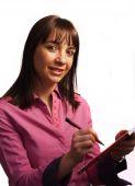 Woman In Fushia Shirt Takes Notes