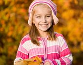 stock photo of mountain-ash  - pretty smiling girl  against the leaves of mountain ash - JPG