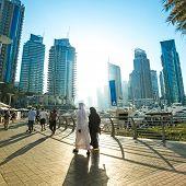 DUBAI, UAE - DECEMBER 14: Modern buildings in Dubai Marina, Dubai, UAE. In the city of artificial channel length of 3 kilometers along the Persian Gulf, taken on 14 December 2013 in Dubai.