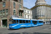 KRAKOW, POLAND - SEPTEMBER 15, 2013: Tram on the street of Krakow. Tramway system operated in the city since 1882, and its length for 2013 was 90 kilometres