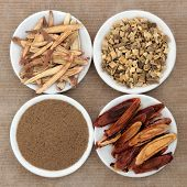 Licorice chinese herbal medicine including powder, chopped and sliced root and honey coated.