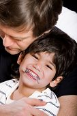 image of physically handicapped  - Father holding his disabled son in arms - JPG