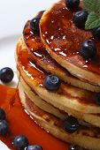 Blueberry Pancakes Drenched  Syrup. Macro Top View
