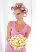 Woman With Curlers And A Bowl Of Popcorn