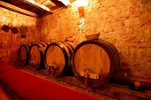Barrels with wine in a cellar