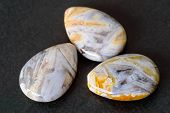 picture of teardrop  - Three needle agate teardrop shaped beads on black stone - JPG