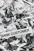 shredded paper tagged with bank customer, symbol photo for data destruction, customer data and banki