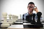 Composite image of confused casual businessman with chessboard