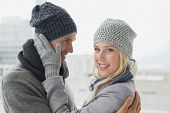 Cute couple in warm clothing hugging on a chilly day