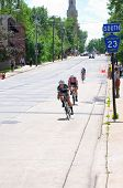 Pro Cyclists At Bottom Of Hill In Stillwater
