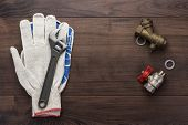 adjustable wrench gloves and pipes