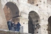 Tourists Visiting The Coliseum