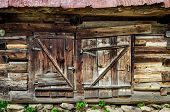 Detail Of Old Wooden Textured And Weathered Barn Door
