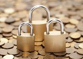 Financial security. Golden coins and padlocks.
