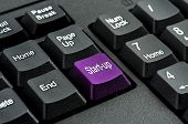 keyboard with the word start-up written on a button