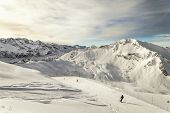 Skiing Among French Alps And Euro-shaped Rock On Background