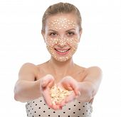 Young Woman With Oatmeal Facial Mask Showing Oatmeal