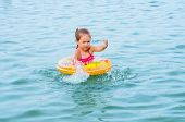 Little girl swimming on the lake
